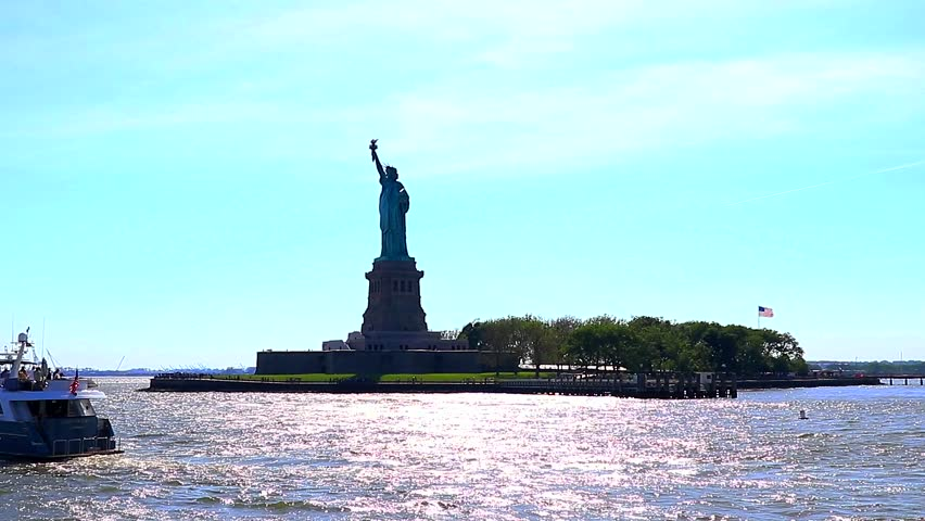 Approaching to Liberty Island in a Ferry with the sun in backlight | Shutterstock HD Video #30500338