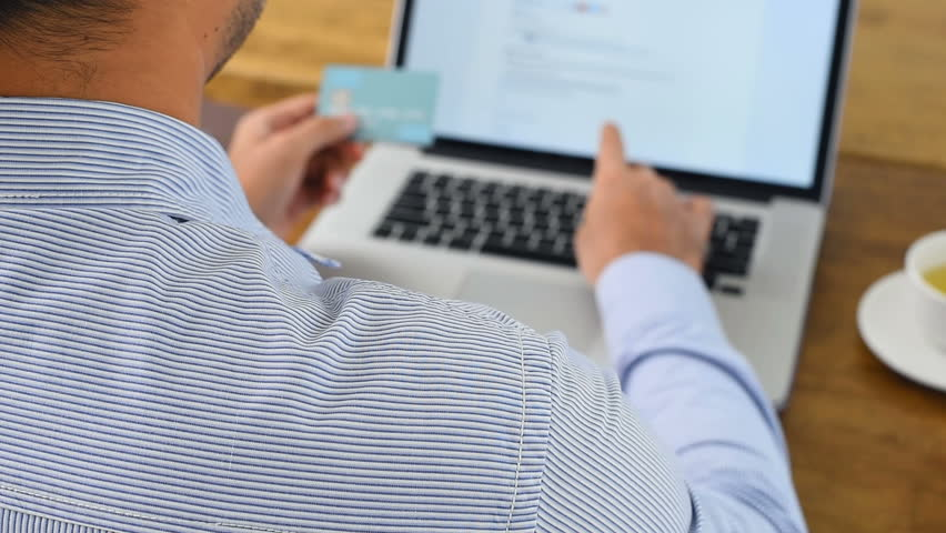 Businessman using laptop computer typing personal identity information while shopping digitally online and paying with credit card Royalty-Free Stock Footage #30501691