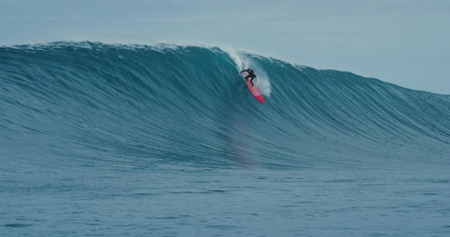 Surfer rides giant blue ocean wave. Shot on RED in 4k. Big wave surfing. Slow motion | Shutterstock HD Video #30504127
