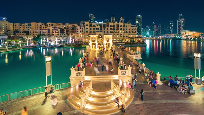 DUBAI, UAE - MAY 2017: Timelapse Evening promenade on the bridge, near the dancing fountain in the Dubai Mall