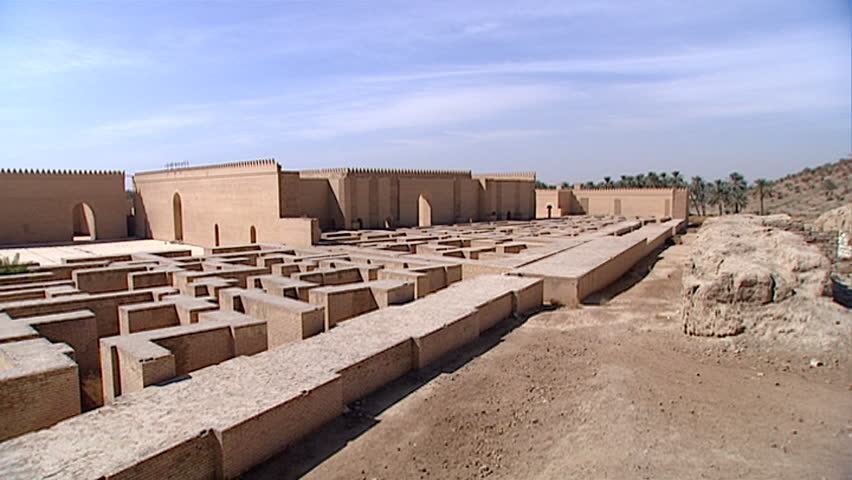 HILLAH, IRAQ - CIRCA 2002: Pan-left across courtyards, crenelated walls, and original fortifications of ancient Babylon. Since 2003 Gulf War occupying forces caused irreparable damage to the site.
