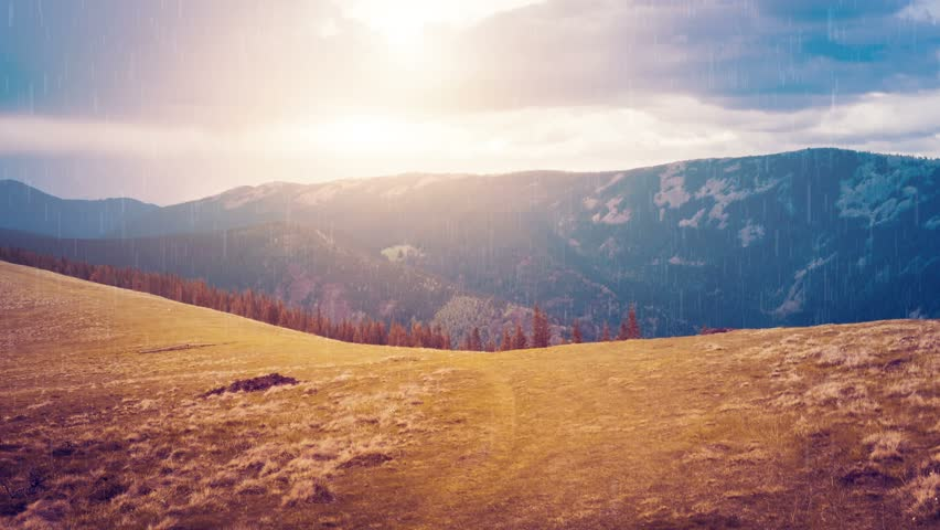 Two seasons: autumn and winter in mountain valley. Majestic nature landscape with orange meadow and blue mountain range. Rain and snow fall in Bukovel, Carpathians, Ukraine. Travel, hiking, holidays | Shutterstock HD Video #30526234