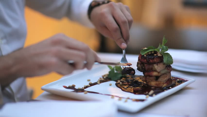Attractive young man tastes foie gras with sauce | Shutterstock HD Video #30536815