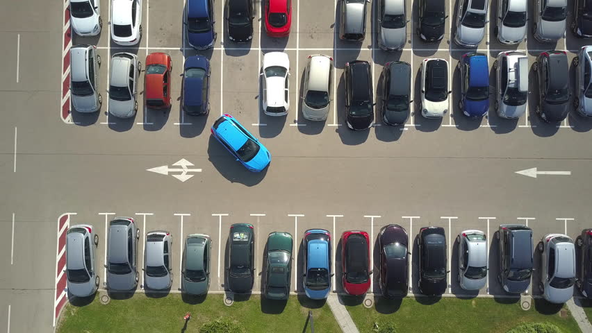 AERIAL TOP DOWN: Flying above bad driver incapable to park a car on parking space in crowded parking lot. A driver having problems, unable to park a car in parking spot. Parking fail on parkspace | Shutterstock HD Video #30572233