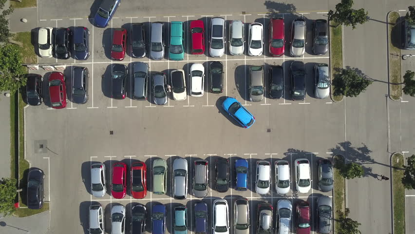 AERIAL TOP DOWN, HYPERLAPSE: Bad driver incapable to park a car on parking space in big crowded parking lot. Driver having problems, unable to park a car in parking spot. Parking fail on parkspace