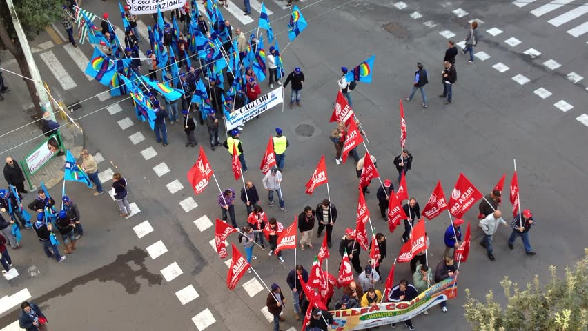 CAGLIARI, ITALY - NOVEMBER 24: Large protest of the workers and the students on November 24, 2012 in Cagliari, Italy.  #3058036