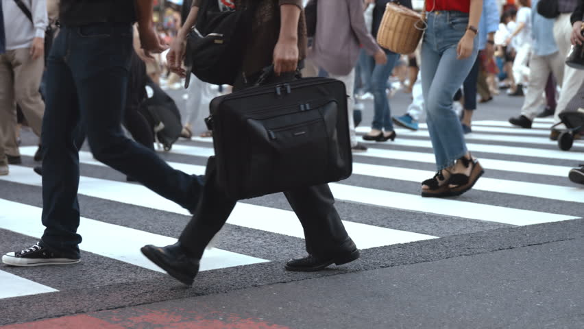 People walking on the crosswalk (Slow Motion Video) Shibuya in Summer It's a slow motion video that people took on crosswalk in Shibuya Tokyo. On the day of summer cloudy. | Shutterstock HD Video #30592474