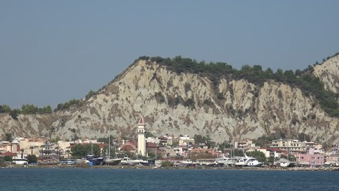 4K Zakynthos Island cityscape with church tower and residential buildings, urban town