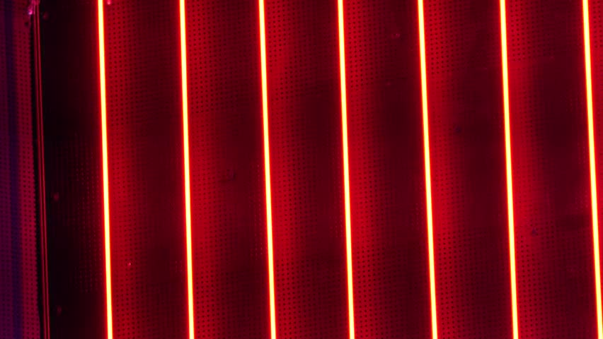4K Neon red light blinking by night at casino, bar signage nightlife, electric effect
