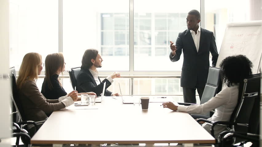 African businessman presenting business offer to partners, black man giving presentation to clients at meeting in conference room, dark skinned team leader reporting about work result with whiteboard | Shutterstock HD Video #30610927