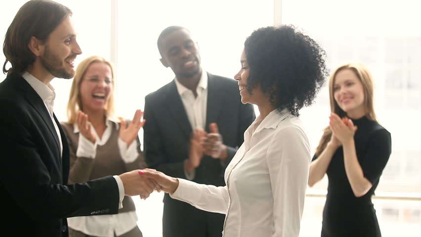 Company boss handshaking promoting african manager while colleagues applaud, businessman congratulates black woman with career achievement, shake hands rewarding for good work, employee of the month #30610954