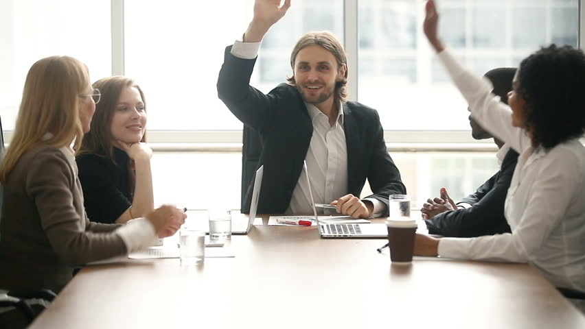 Happy motivated successful team put join hands up together, five partners giving high-five sitting at conference table in office, expressing unity in business, promising help and support in teamwork Royalty-Free Stock Footage #30610975