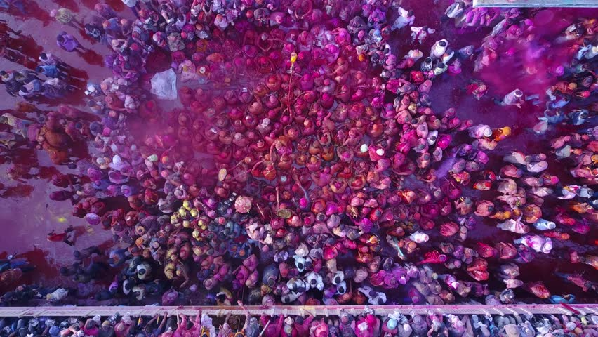 Color battle at the holi festival in India, 4k aerial shot #30611023