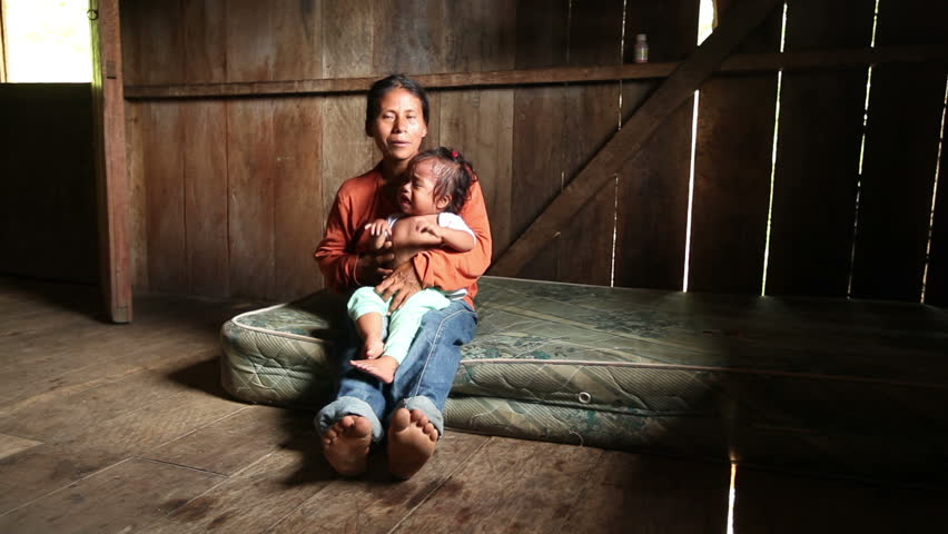 Mother and child living in very poor conditions, Ecuadorian Amazonia