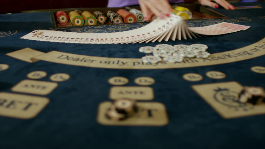 Casino: Dealer woman shuffles the poker cards. Shot on RED EPIC DRAGON Cinema Camera in slow motion.