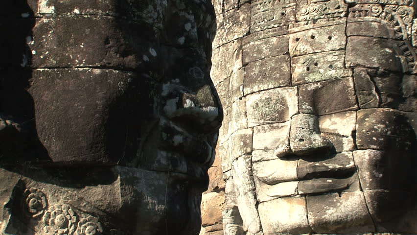 Zoom out from a face at Angkor Wat, Siem Reap, Cambodia