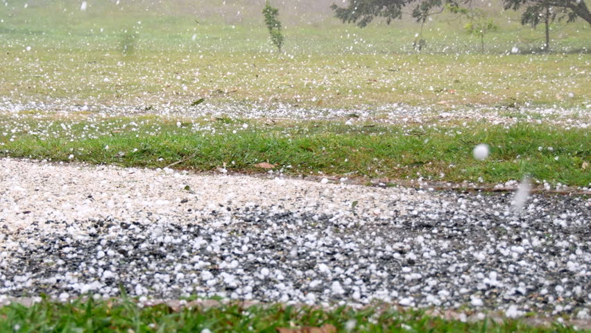 Heavy hail stones falling during violent storm on rural property