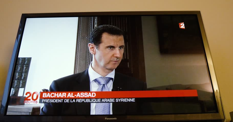PARIS, FRANCE - APR 20, 2015: Time-lapse fast motion of interview of Syrian President Bashar al-Assad to David Pujadas from France TV on TV screen in living room on evening news special edition | Shutterstock HD Video #30675244
