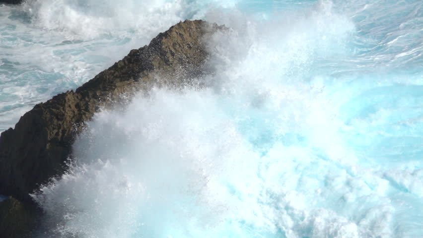 SLOW MOTION CLOSE UP: Huge turbulent foamy ocean wave breaking. Perfect barrel wave rolling upon the shore splashing. Big powerful swell wave crushing over the sharp rocky reef spraying sea waterdrops #30680143