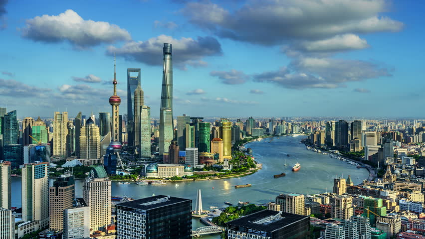 "Zoom in timelapse: Shanghai skyline,China. Aerial view of high-rise buildings with Huangpu River. >>> Please search more similar: ""ShanghaiSkyline"""