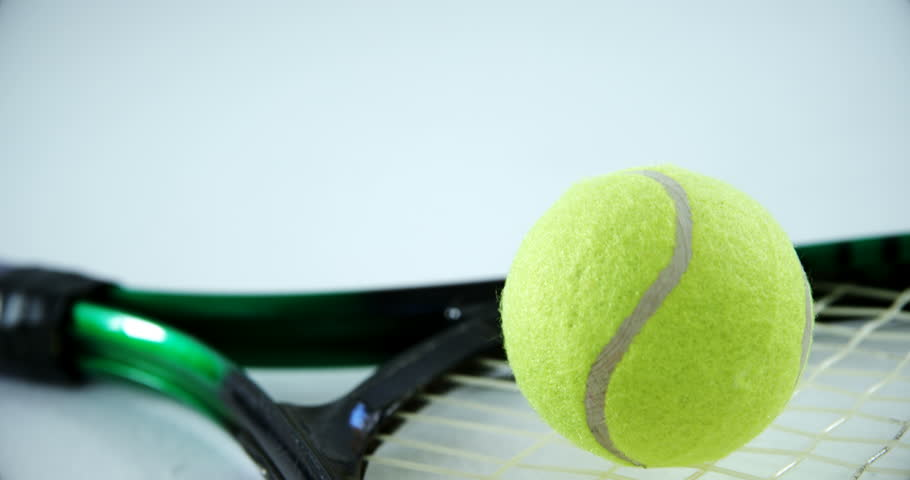 Close-up of racket and tennis ball on white background 4k #30697726