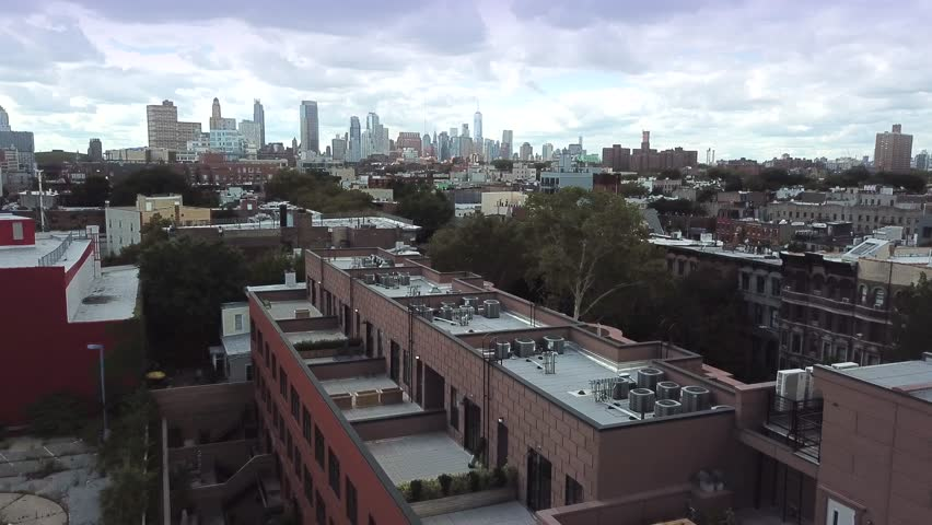 Brooklyn, Clouds NYC AERIAL with Manhattan Skyline, 2017, Bedford-Stuyvesant area. Could be darkened for mood.. | Shutterstock HD Video #30704167