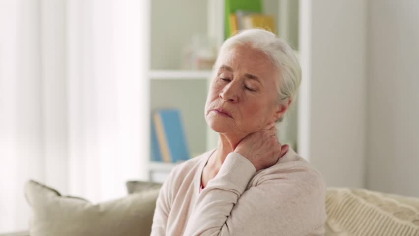 Old age, health problem and people concept - senior woman suffering from neck pain at home | Shutterstock HD Video #30711820