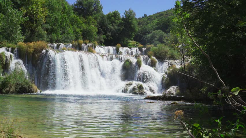 Krka National Park Croatia. Beautiful summer day at the lakes, Nice crystal clear water. Calm, peaceful outdoors video. Lovely nature and landscape. Happy, relaxing and joyful clip of waterfalls.
