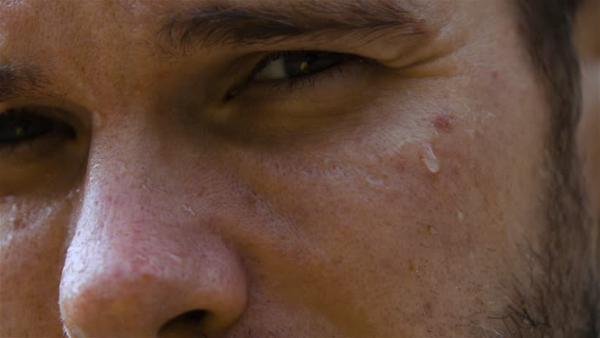 Epic extreme close-up shot. Eye and nose. sweat man outdoor in park. Drop of water on his face macro slow motion high-speed fps rapid camera.