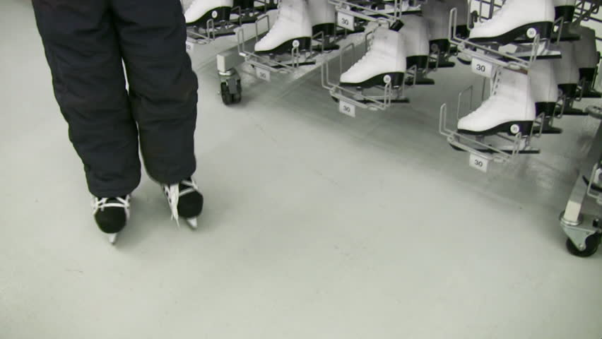 Child legs with skates in shop  | Shutterstock HD Video #307306
