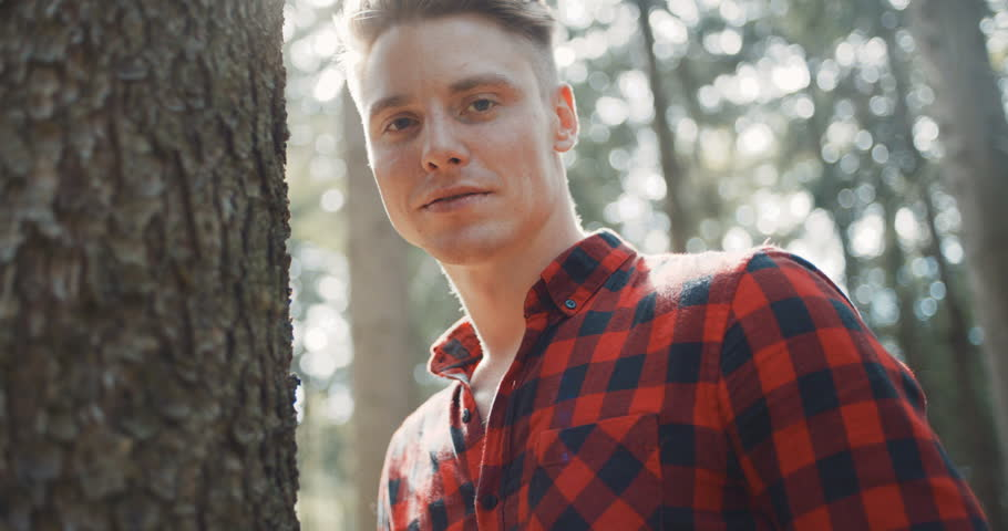 Portrait of handsome man over green nature. Adventure, travel, tourism and leisure concept -  smiling boy relaxing in woods.   Shutterstock HD Video #30752989