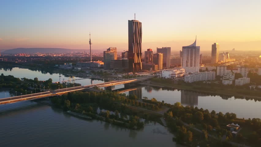 Aerial view of vienna skyscrapers modern city at sunrise flying over danube bridge | Shutterstock HD Video #30761548