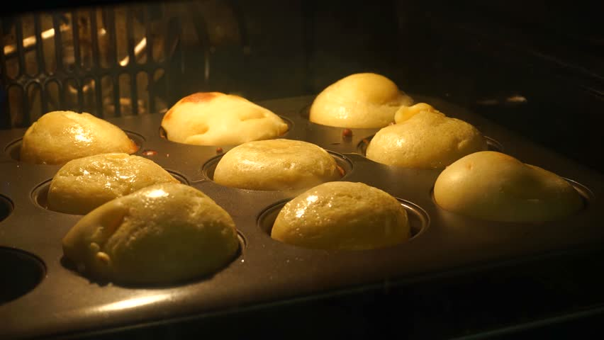 Time Lapse of Yorkshire Puddings Rising in Oven | Shutterstock HD Video #30770020