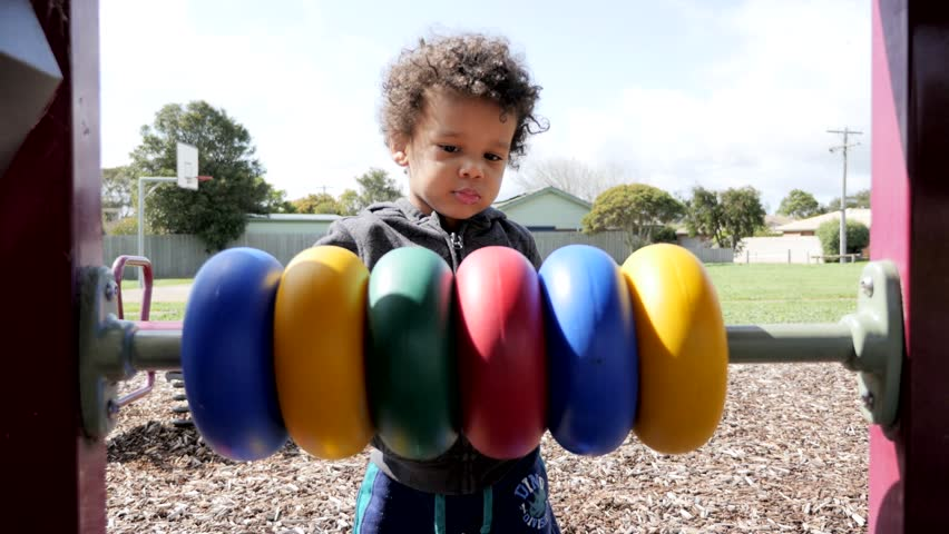 Black child plays with color toys and walk off | Shutterstock HD Video #30771571