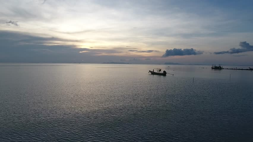 Aerial : Forward Drone shooting of a sunrise on infinite sea in Phuket Thailand Asia, view fishing boat, sky before sunrise, tropical    Shutterstock HD Video #30774562