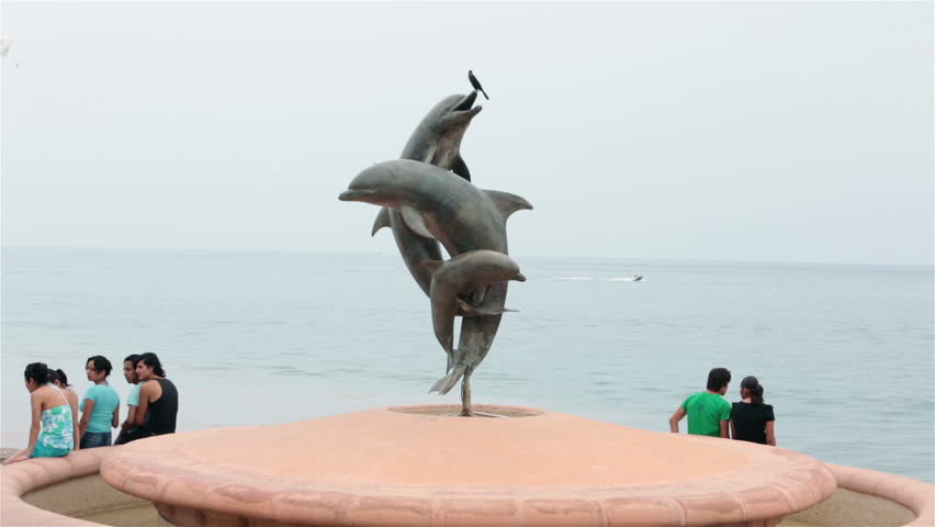 PUERTO VALLARTA, MEXICO - CIRCA NOV 2012: Malecon Friendship Fountain dolphin circa November 2012 in Puerto Vallarta, Mexico.