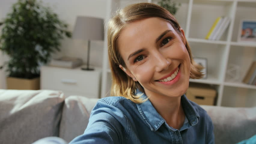 Close up shot of attractive happy woman using camera for video chatting with friends, family at home in the living room. | Shutterstock HD Video #30793339