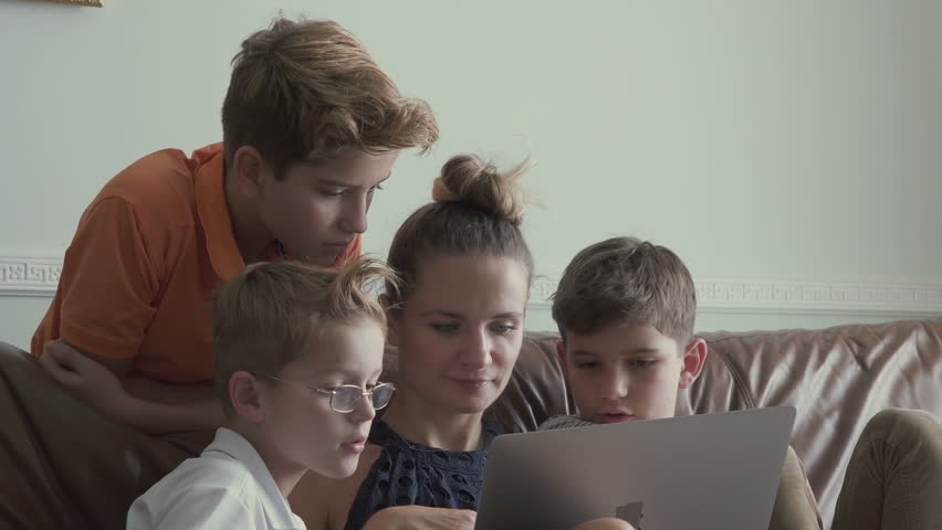 Woman with little sons watches movie on laptop at home | Shutterstock HD Video #30793927