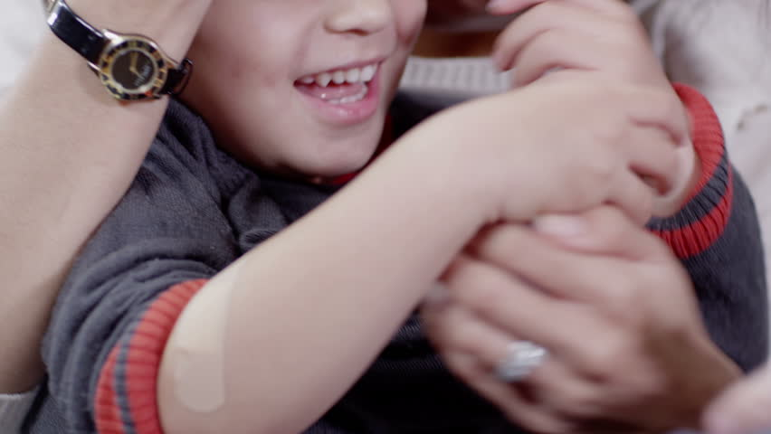 Little boy gets a sticking plaster on his arm | Shutterstock HD Video #3079546