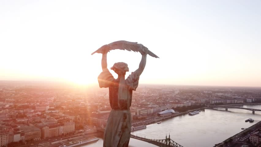 Aerial footage of Budapest, Hungary, at  Sunrise with intense flare, by the liberty statue and view of the early sun over the city.   Shutterstock HD Video #30802963