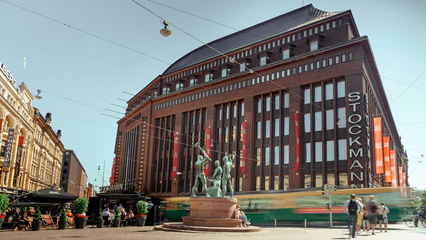 HELSINKI, FINLAND - JULY 09, 2017: statue of three blacksmiths (Kolmen sepan patsas) in front of Stockmann department store, time lapse