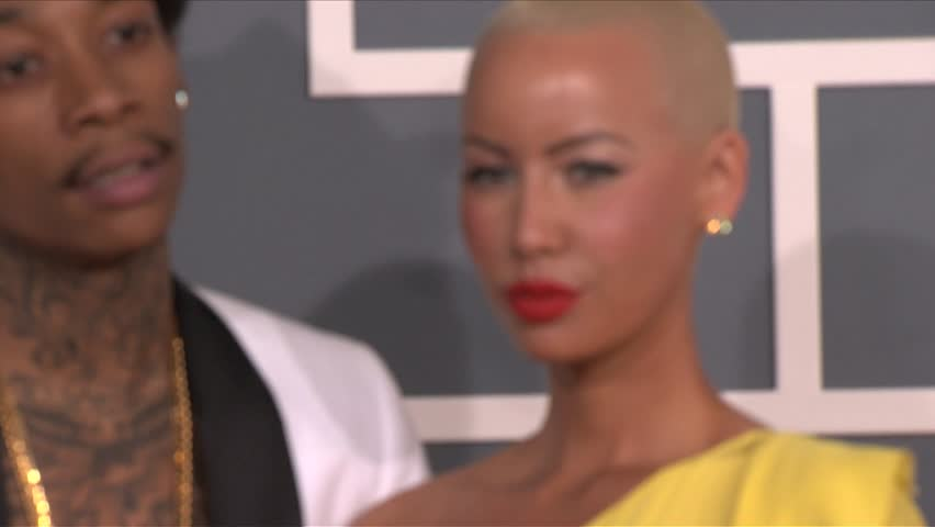 Los Angeles, CA - FEBRUARY 12, 2012: Wiz Khalifa, Amber Rose, walks the red carpet at the Grammy Awards 2012 held at the Staples Center | Shutterstock HD Video #3080956