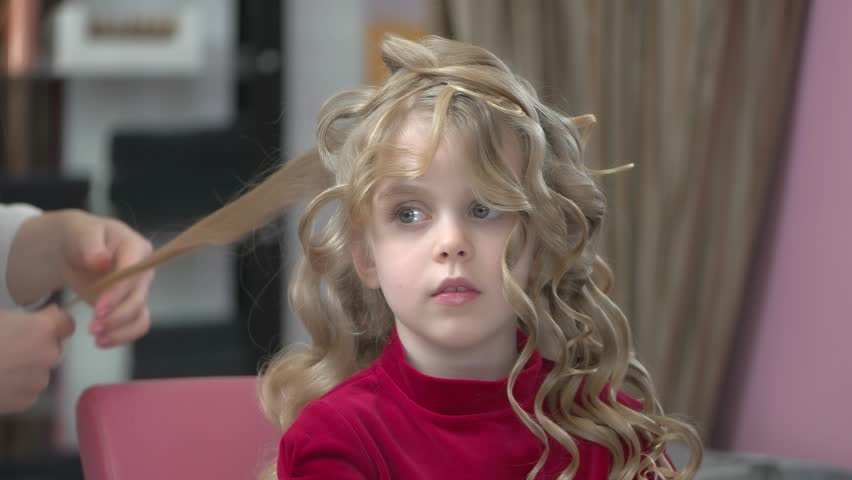 Little girl with curly hair. Kid at the hairdresser. | Shutterstock HD Video #30823333