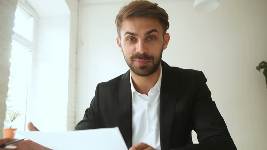 Successful businessman talking on web camera about document with statistics, consultant making offer to client by video call, vlogger recording videoblog, training for effective business introduction