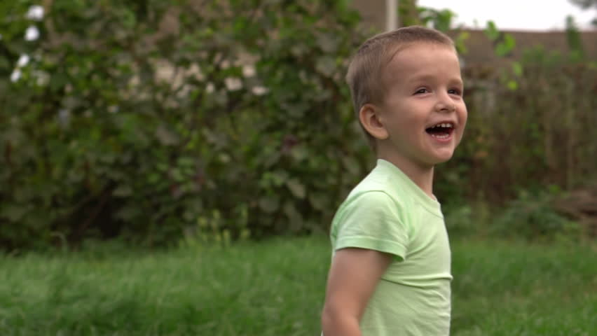 little boy waves his hands joyfully. Slow motion #30838312