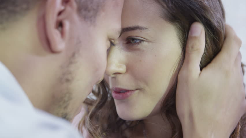 Happy young couple enjoying an intimate moment, laughing a lot and man gently strokes his partner's hair | Shutterstock HD Video #3085036