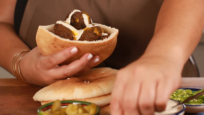 Female chef's hands cook Falafel or felafel deep-fried ball made from ground chickpeas Tahini Middle East | Shutterstock HD Video #30859495