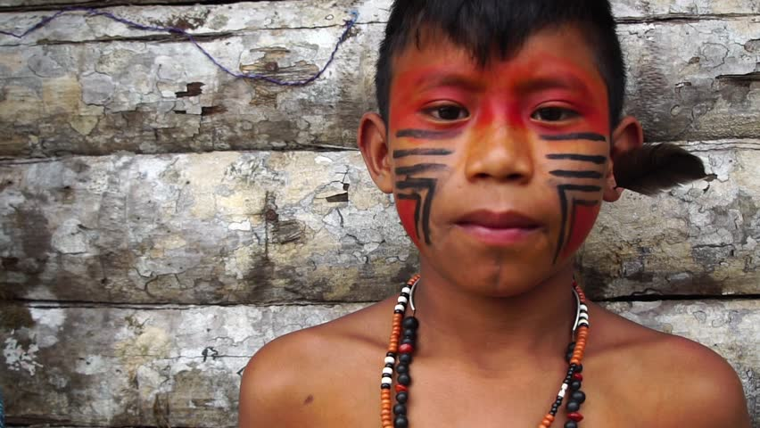 Native Brazilian Boy on a indigenous Tupi Guarani Tribe in Brazil