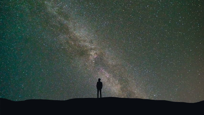 The man stand on a background of a milky way with asteroids skyfall. time lapse  #30866656