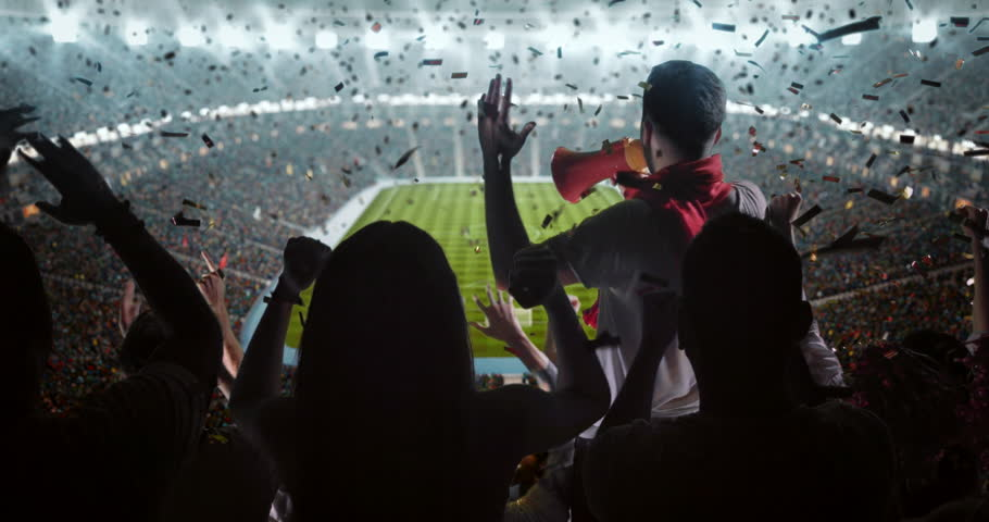 Fans cheering for sports team on the bleachers of a professional stadium